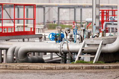 Oil refinery. Detail of oil pipeline with valves in large oil refinery stock images