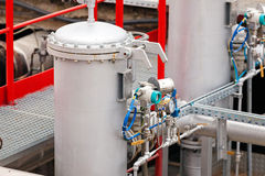 Oil refinery. Detail of oil pipeline with valves in large oil refinery stock image