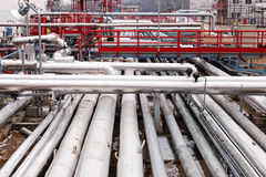 Oil refinery. Detail of oil pipeline with valves in large oil refinery royalty free stock photos