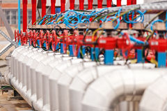 Oil refinery. Detail of oil pipeline with valves in large oil refinery stock photo
