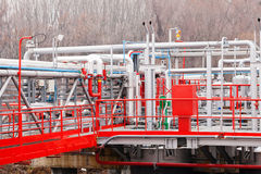 Oil refinery. Detail of oil pipeline with valves in large oil refinery royalty free stock images