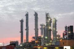 Oil refinery at dramatic sunrise. Oil factory, petrochemical plant in Corpus Christi, Texas, USA. Petroleum industry background Stock Photo