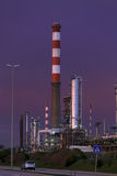 Oil refinery at dusk Stock Images
