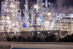 Oil refinery and electrical generation. An oil refinery in the United States with a series of foggy and smoky stacks. Electrical generation at a oil plant Stock Images