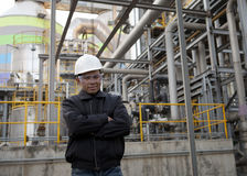 Oil refinery engineer. Engineer oil refinery inside industrial construction Royalty Free Stock Photo