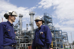 Oil refinery and engineers Stock Photo