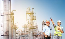 Oil refinery. Engineers and oil refinery And evening light royalty free stock images