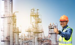 Oil refinery. Engineers and oil refinery And evening light royalty free stock photos