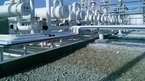 The oil refinery. Equipment for primary oil refining stock photos