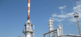The oil refinery. Equipment for primary oil refining stock photography
