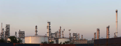 Oil refinery in the evening of panorama style. Royalty Free Stock Images