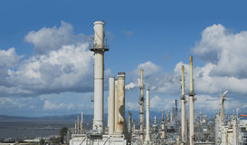 Oil refinery exterior towers and structure Stock Photos