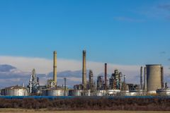 Oil refinery with facilities. Tanks and trains royalty free stock images