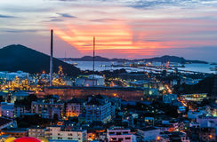 Oil Refinery Factories Beside Seaport st Sunset Royalty Free Stock Photos