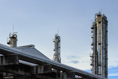 Oil refinery factory at evening. Time Stock Images