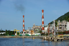 Oil refinery factory near sea Royalty Free Stock Images