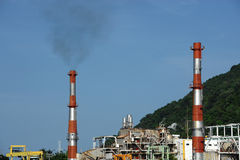 Oil refinery factory near sea Royalty Free Stock Photo