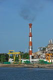 Oil refinery factory near sea Stock Image