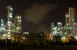 Oil refinery factory at night. Oil refinery in full operation during the night, industrial estate, Thailand Stock Photos