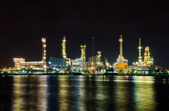 Oil refinery factory at night Stock Image
