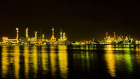 Oil refinery factory at night Stock Images