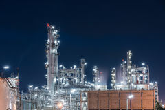 Oil Refinery factory, petrochemical plant. Petroleum at dark Stock Image