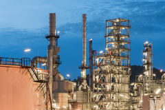Oil Refinery factory, petrochemical plant. Petroleum at dark Stock Photos