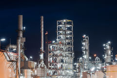 Oil Refinery factory, petrochemical plant. Petroleum at dark Stock Photo