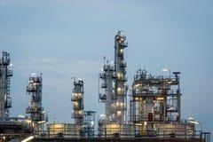 Oil Refinery factory Petroleum at twilight sunset Stock Photos