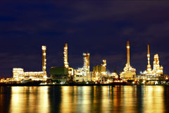Oil refinery factory with reflection on the river. Stock Photo