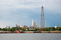 Oil refinery factory at river Thailand Stock Photo