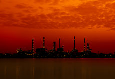 Oil refinery factory in silhuette Stock Images