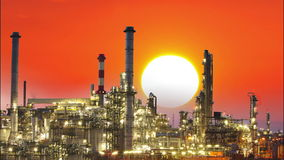 Oil refinery, factory with sun at sunset stock video footage