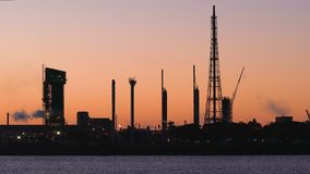Oil refinery or factory at sunset stock video