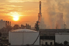 Oil Refinery factory at sunset Royalty Free Stock Photos