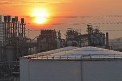 Oil Refinery factory at sunset Stock Photo