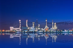 Oil refinery factory at Twilight Stock Images