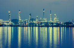 Oil refinery factory at twilight Bangkok Thailand Stock Photo