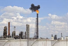 Oil Refinery with Fire and Smoke Stock Photo