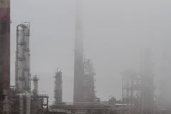 Oil refinery in  fog Royalty Free Stock Photo