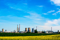 Oil Refinery. Fuel refinery with furnaces under blue sky Royalty Free Stock Image