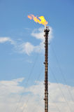 Oil Refinery Gas Flare. With Tall Chimney Against Blue Sky royalty free stock photos