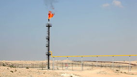 Oil refinery gas flare. In the desert of Bahrain, Middle East stock video footage