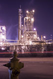 Oil refinery industrial center. An oil refinery in the United States with a series of foggy and smoky stacks. industial complex in a refinery Royalty Free Stock Photography