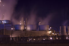 Oil refinery industrial location. An oil refinery in the United States with a series of foggy and smoky stacks. Industrial refinery incinerators Stock Photography