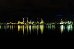 Oil refinery industrial in nighttime. Background Stock Images