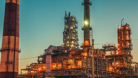 Oil refinery industrial plant or factory panorama, storage distillery tanks and steel pipeline, modern petrochemical technologies. Toned royalty free stock photo