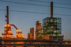 Oil refinery industrial plant or factory panorama, storage distillery tanks and steel pipeline, modern petrochemical technologies. Toned royalty free stock image