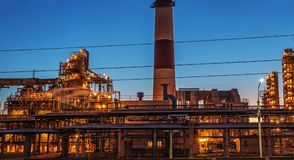 Oil refinery industrial plant or factory panorama, storage distillery tanks and steel pipeline, modern petrochemical technologies. Toned stock images