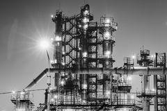 Oil refinery industrial plant or factory, storage distillery tanks and steel pipeline, modern petrochemical technologies. Black and white photo stock image